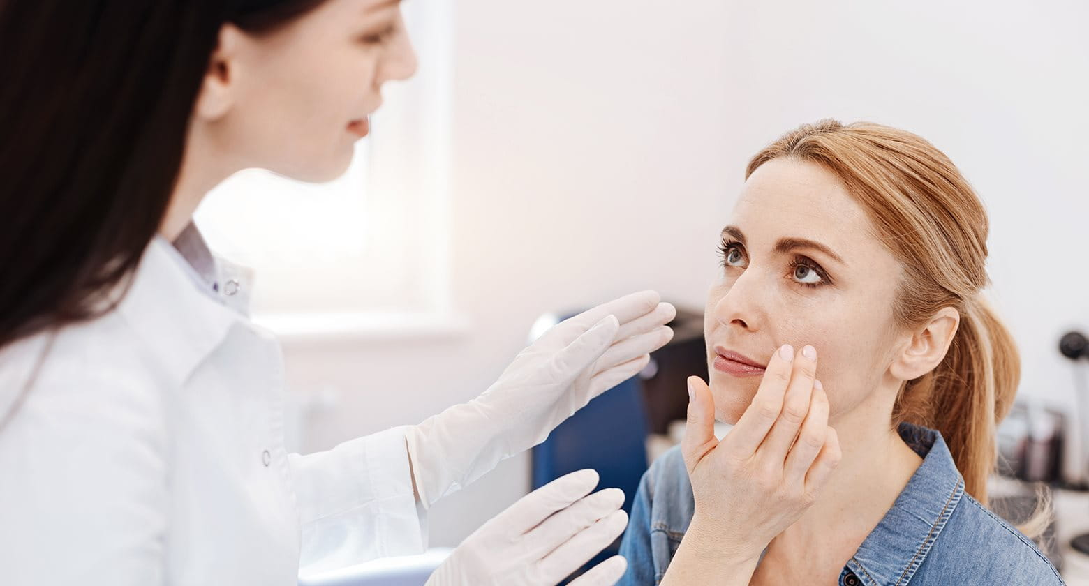 Acne doctor examining skin