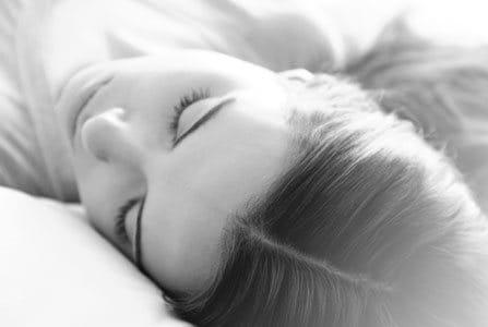 Sleeping woman with healthy scalp