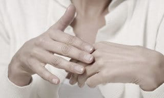Two female hands.