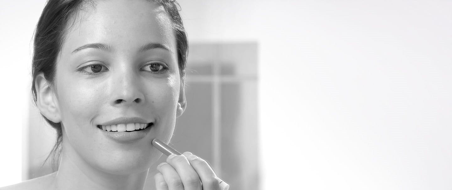 Young woman using Eucerin DermoPURIFYER Cover Stick