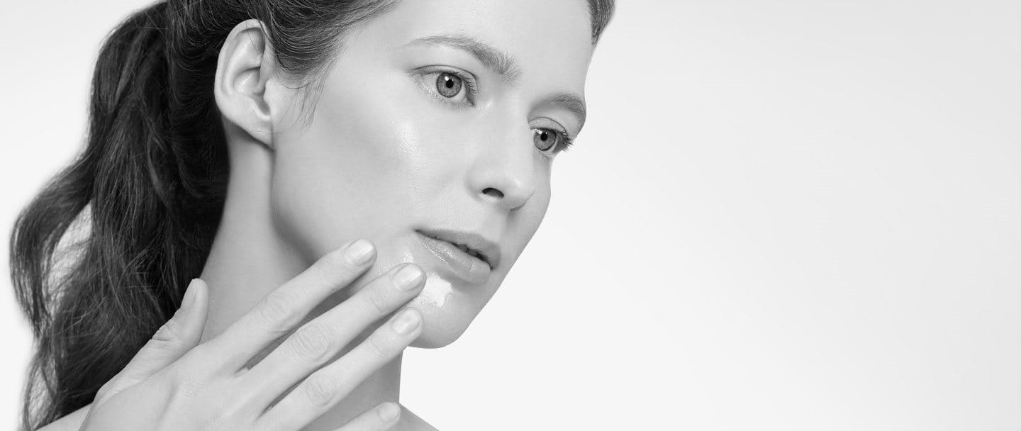 Woman touching her face with hand