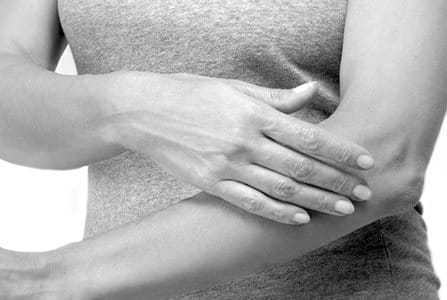 Woman applying cream on her arm